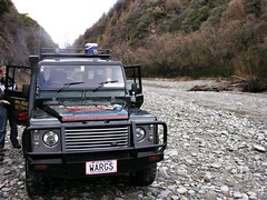 safari(0.0), automobile(1.0), automotive exterior(1.0), sport utility vehicle(1.0), vehicle(1.0), off-roading(1.0), land rover defender(1.0), off-road vehicle(1.0), bumper(1.0), land vehicle(1.0),