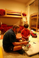 chips and nick playing with legos  in the kids' room…