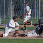 Malik James (6) applies the tag for the out at third_5867