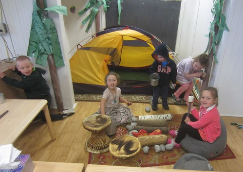 campers cooking over the campfire