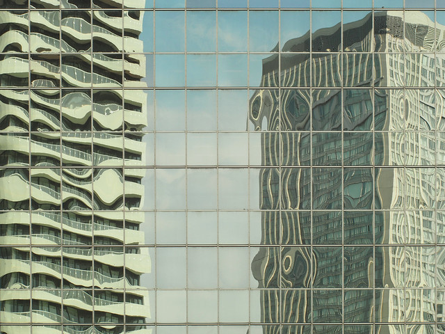 Glass buildings reflected in another glass building