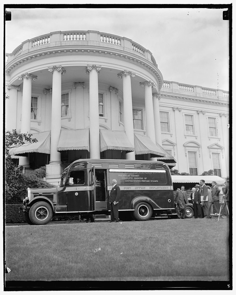 Postmaster General James A. Farley and the United States Post Office Department's Philatelic Truck at the White House in Washington, D.C. on May 9, 1939. From the Harris & Ewing photograph collection in the United States Library of Congress, catalogued under the reproduction number LC-DIG-hec-26655.