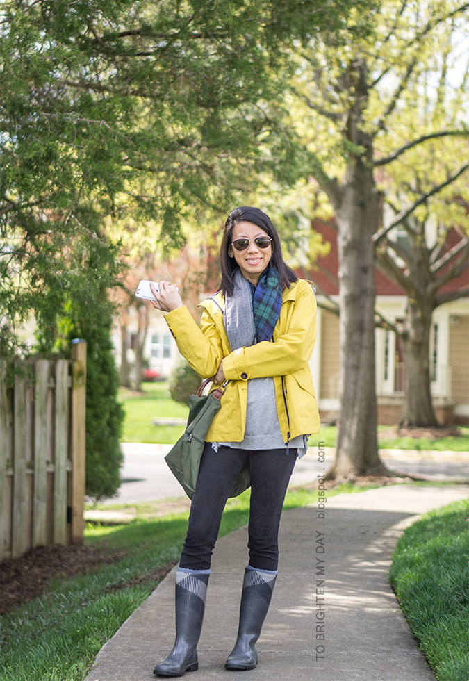 plaid and herringbone infinity scarf, yellow rain jacket, gray tunic top, olive green crossbody bag, checked rain boots