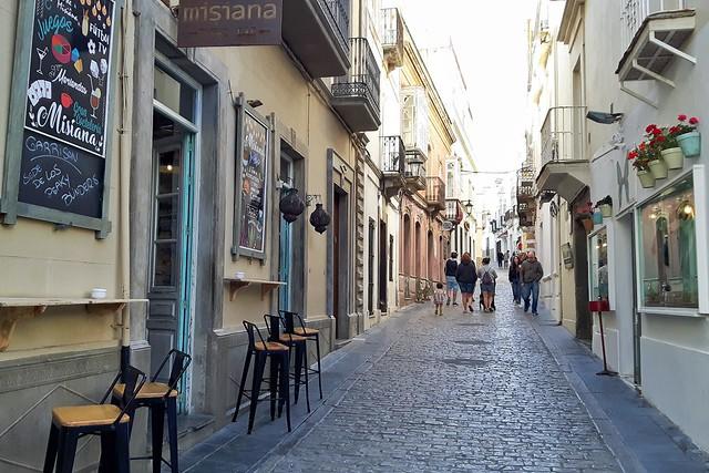 A narrow street and bar in old town Tarifa, Spain