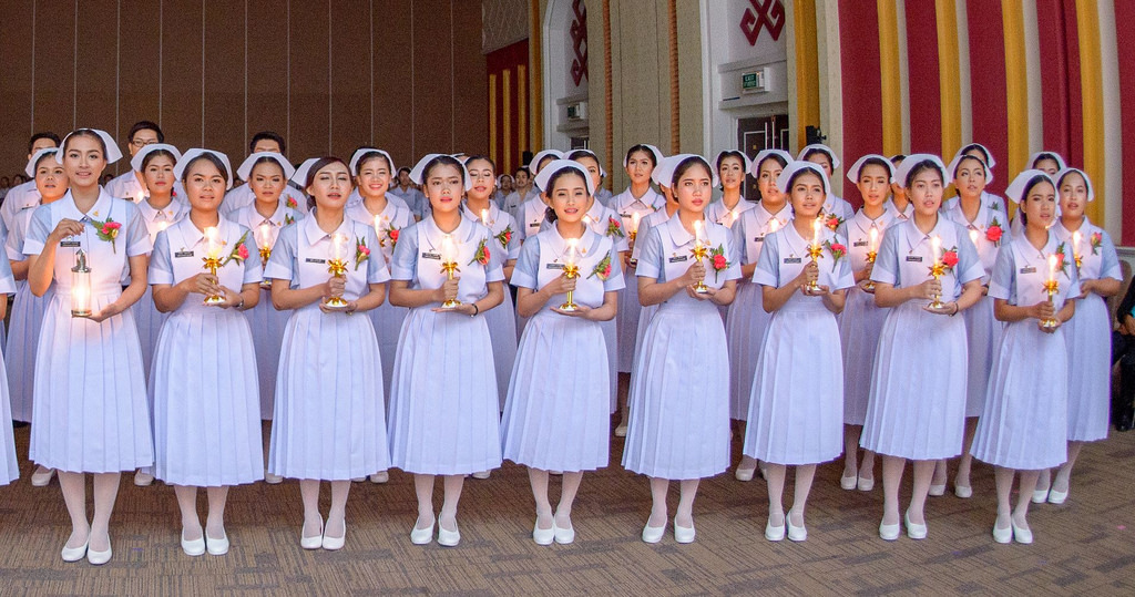 Nurses in Phuket, Thailand, hold a candle-lighting ceremony.