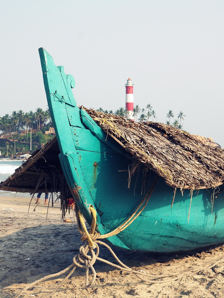 kovalam beach travel guide turquoise boat lighthouse_effected