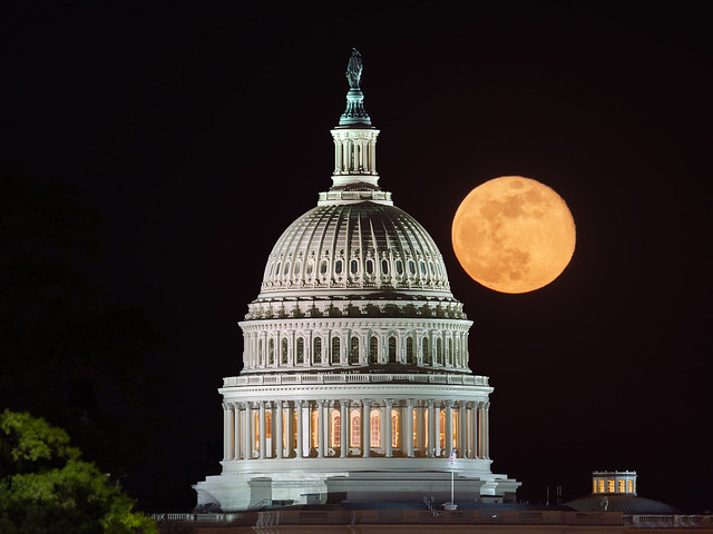 April's Pink Moon over the US Capitol Dome
