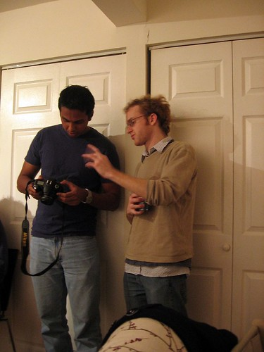 Toby explains to Bo how to use his camera