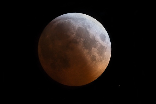 lunar eclipse with star